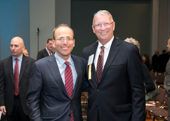Jonathan Kraft and Brian Thompson at our 30th Annual Meeting in 2015